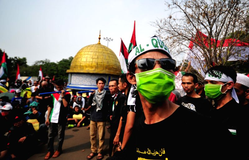 Indonesian people attend a demonstration to mark Al-Quds Day in front of U.S. Embassy in Jakarta, capital of Indonesia, on July 10, 2015. Hundreds of demonstrators ...
