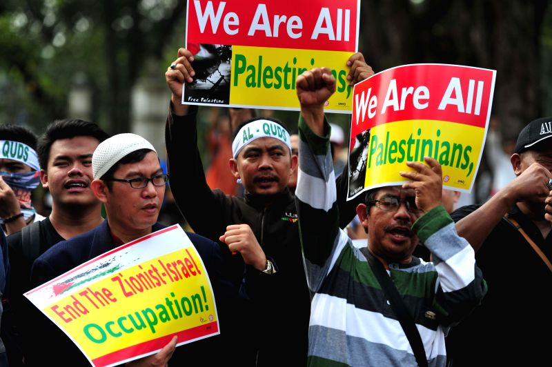 Indonesian people shout slogans during a demonstration to mark Al-Quds Day in front of U.S. Embassy in Jakarta, capital of Indonesia, on July 10, 2015. Hundreds of ...