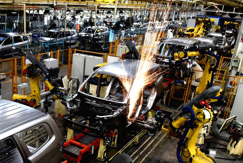 Industrial robots are used for welding vehicle bodies at Liuxin Auto Stamping Co., Ltd. in Liuzhou, southwest China's Guangxi Zhuang Autonomous Region, Nov. 18, ...