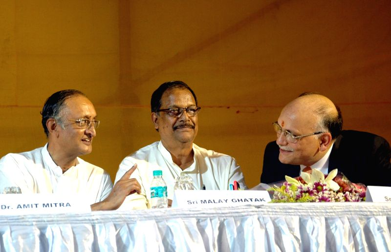 Industrialist and owner of Jessop, Pawan Ruia, Industry Minister Amit Mitra and Minister Malay Ghatak during Jessop factory re-open after three month in Kolkata on Aug 9, 2014. - Amit Mitra