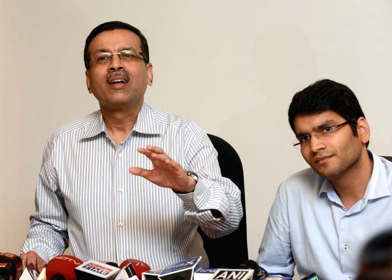 Industrialist and owner of the newly bought Pune IPL franchise Sanjiv Goenka with his son Saswat during a press conference in Kolkata on Dec 8, 2015.