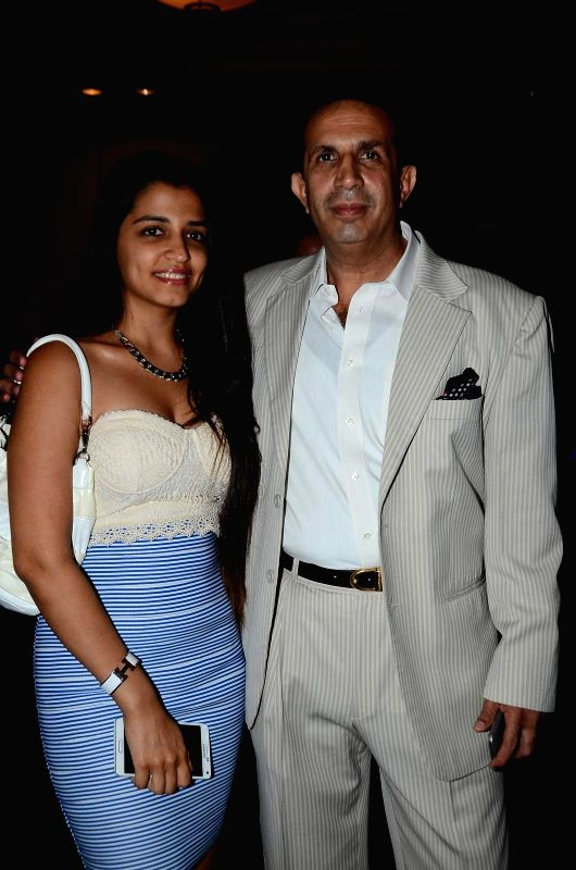 Industrialist Parvez Damania with his daughter during the inauguration of solo exhibition by artist Sharvari Luth in Mumbai.