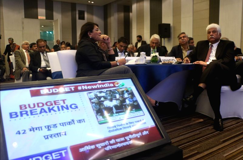 Industrialists Sunil Kant Munjal, Rakesh Bharti Mittal with others at CII headquarter watching Union Budget presented by Union Finance Minister Arun Jaitley in New Delhi on Feb. 1, 2018. - Arun Jaitley