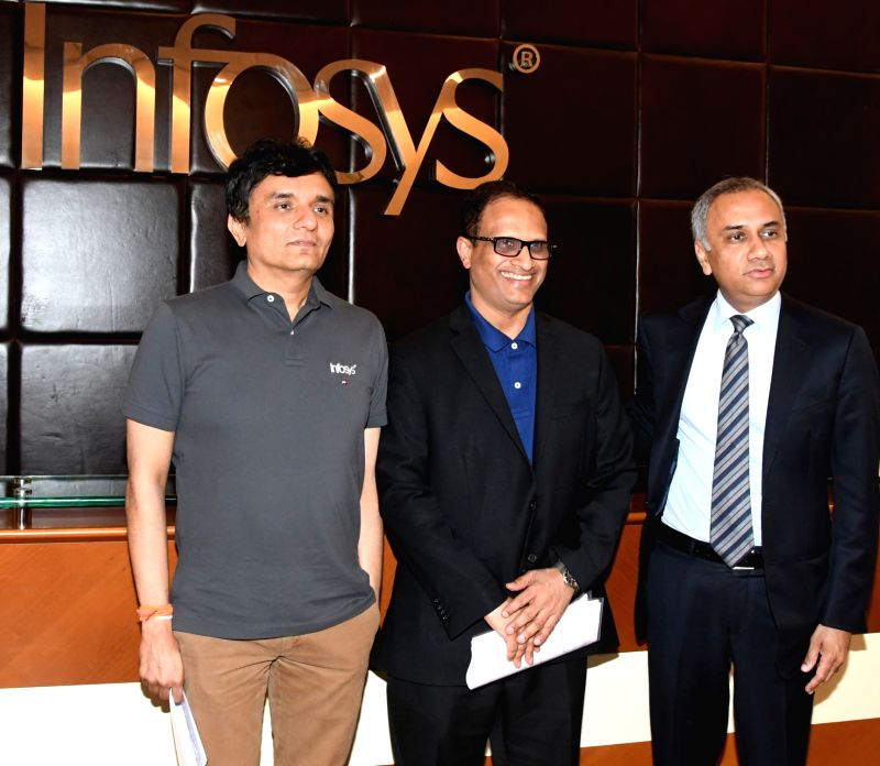 Infosys CFO M D Ranganath, CEO and MD Salil Parekh and COO UB Pravin Rao during a press conference in Bengaluru, on April 13, 2018. - Pravin Rao