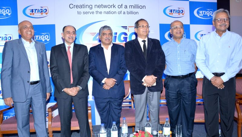 Infosys co-founder Nandan Nilekani with Accel  Managing Partner Subrata Mitra, The Federal Bank MD Shyam Srinivasan and others during a4TiGO, The Truck Network press conference in ...