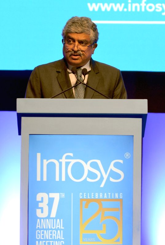 Infosys Non-Executive Chairman Nandan Nilekani addresses at the 37th Annual General Meeting of Infosys at Christ University Auditorium, in Bengaluru on June 23, 2018.(Image Source: IANS)