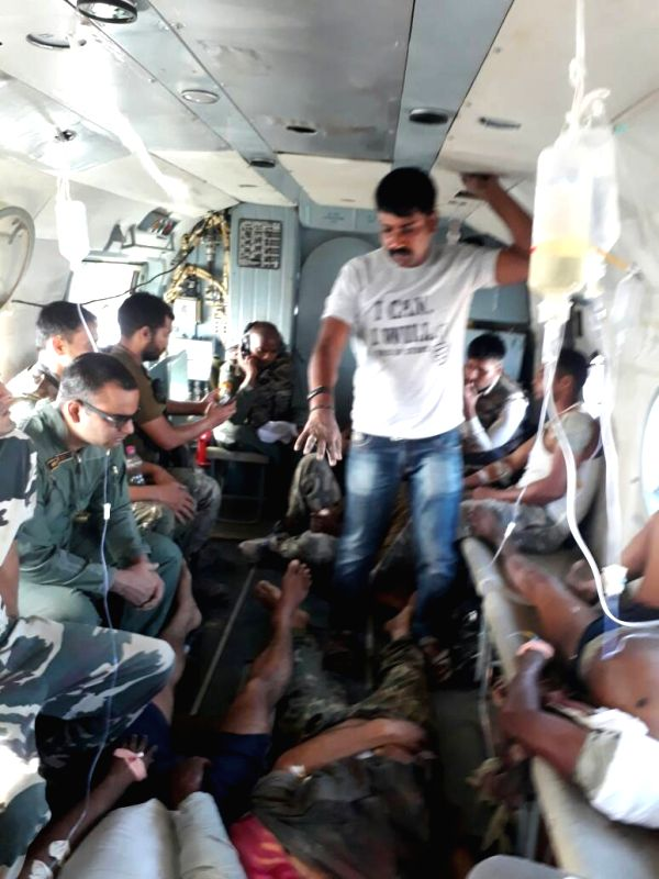 Injured CRPF personnel being evacuated by helicopter after Maoists ambushed them in Chhattigarh's Sukma district on April 24, 2017. At least 24 personnel were killed in the attack that took ...