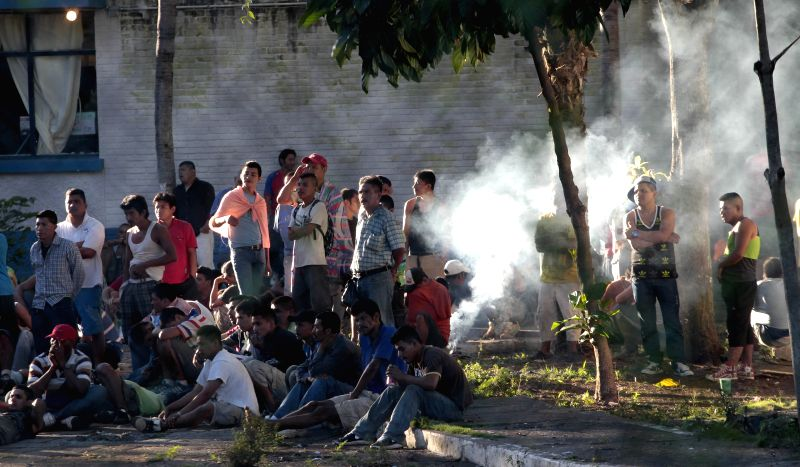 Inmates are seen in a prison where a riot allegedly broke out between rival incarcerated gangs, in Escuintla department, Guatemala, on Nov. 30, 2015. At least 17 ...