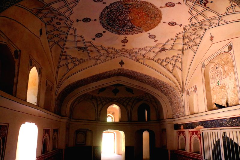 Inside of the Mirza Muzaffar Hussain's Tomb in the Sundar Nursery complex. The motif on the ceiling contrasts the pre- and post-restoration phases of the complex. (Photo: Bidesh Manna/IANS)
