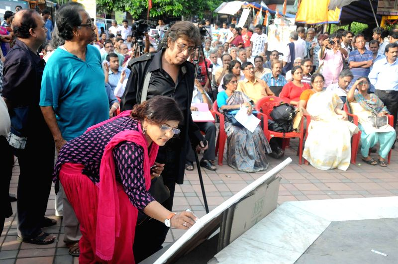 Intellectuals including Papiya Adhikari and Wasim Kapur participate in a demonstration organised in front of Academy of Fine Arts in Kolkata on July 16, 2014.