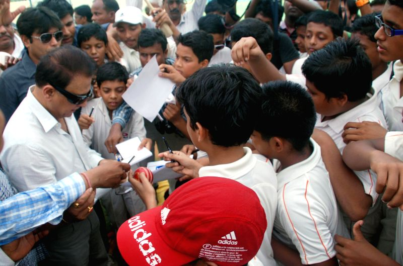 Interim chief of the Board of Control for Cricket in India (BCCI) and former cricketer Sunil Gavaskar gives autographs to his fans at Pragati sporting in Bhubaneswar on May 12, 2014. (Photo : ...