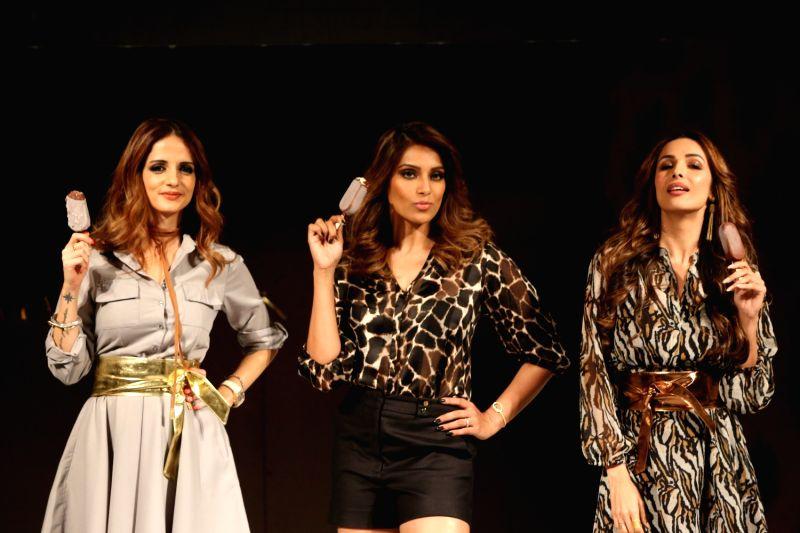 Interior designer Sussanne Khan, actress Bipasha Basu and Malaika Arora during an event in Mumbai on May 2, 2017. - Bipasha Basu, Sussanne Khan and Malaika Arora