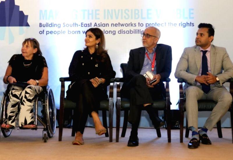International Federation of Spina Bifida & Hydrocephalus President Dr. Margo Whiteford, actress Raveena Tandon, Spina Bifida Foundation Founder Trustee Santosh Karmakar, Vitabiotics ... - Raveena Tandon and Rohit Shelatkar