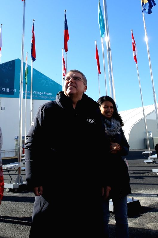 International Olympic Committee (IOC) President Thomas Bach (L) tours the athletes' village for the PyeongChang Olympics in Gangneung, Gangwon Province, on Feb. 1, 2018.