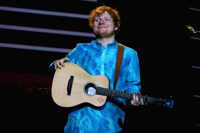 "International Singer Ed Sheeran performs during his concert ""Divide Tour"" in Mumbai on Nov 19, 2017.(Image Source: IANS)"