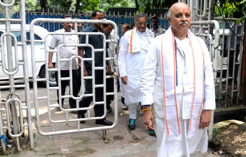 International working president of Vishva Hindu Parishad Pravin Togadia arrived at the Kolkata Press club in Kolkata on Aug 23, 2014.