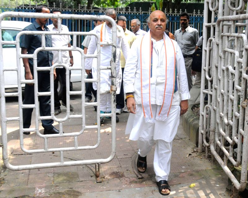 International working president of Vishva Hindu Parishad Pravin Togadia arrived at the Kolkata Press club in Kolkata on Aug 23, 2014.