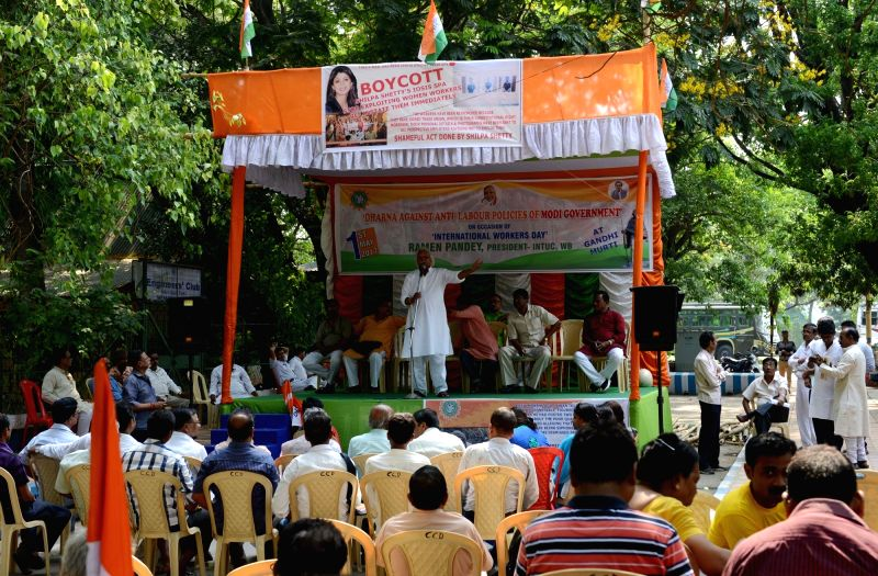 INTUC members participate in a rally against Anti Labour Policies of Modi Government on International Workers' Day in Kolkata on May 1, 2017.