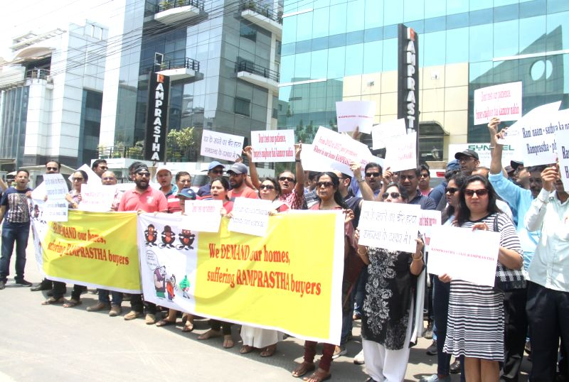 Investors and buyers stage a demonstration against Ramprastha builders in Gurgaon on May 13, 2017.