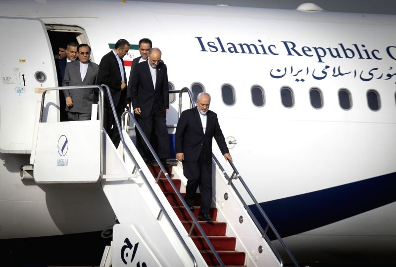 Iranian Foreign Minister Mohammad Javad Zarif (bottom) and other negotiators arrive at Tehran's Mehrabad Airport, Iran, on July 15, 2015. Iran and six world major ... - Mohammad Javad Zarif
