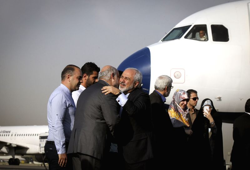 Iranian officials welcome Iranian Foreign Minister Mohammad Javad Zarif (R front) and other negotiators upon their arrival at Tehran's Mehrabad Airport, Iran, on ... - Mohammad Javad Zarif