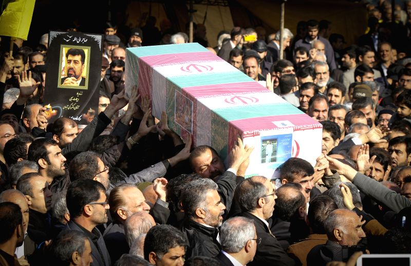 Iranians carry the coffin of Iran's former ambassador to Lebanon Ghazanfar Roknabadi, who died in the Hajj stampede in Saudi Arabia in September, during his funeral ...