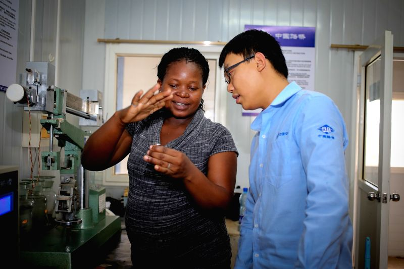 Isabella Khaemba (L) works with Chinese engineer Ren Zhichao, in a cement lab on section two of Kenya's Standard Gauge Railway project, in Taita-Taveta, Kenya, on ...