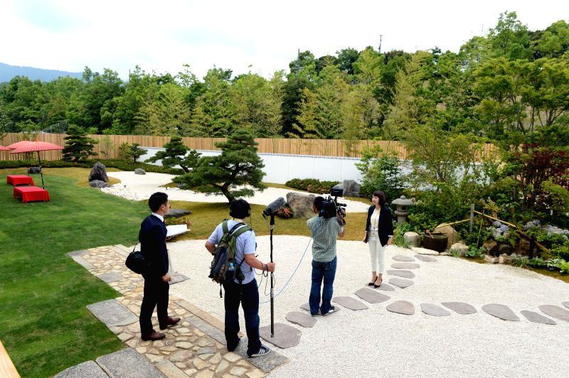 ISE-Journalists work outside the Japanese exhibiting hall of the media center of G7 summit in Ise-Shima, Mie Prefecture, Japan, May 25, 2016. The media center of G7 ...
