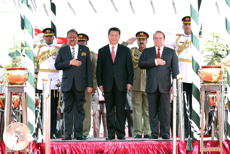 Chinese President Xi Jinping (C) attends a welcoming ceremony held by Pakistani President Mamnoon Hussain and Prime Minister Nawaz Sharif in Islamabad, capital ... - Nawaz Sharif