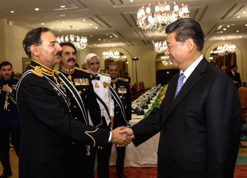 Chinese President Xi Jinping (R) meets with Pakistani Chairman Joint Chiefs of Staff Committee Rashad Mahmood, Chief of the Army Staff Raheel Sharif, Chief of ...