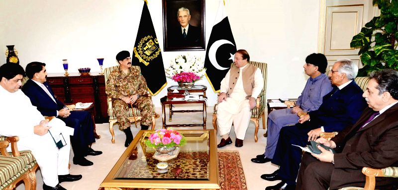 Photo released by Press Information Department (PID) on April 28, 2014 shows Pakistani Prime Minister Muhammad Nawaz Sharif (4th L) attending a meeting to review
