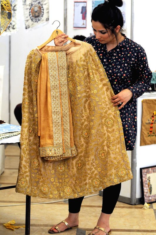 ISLAMABAD, April 30, 2017 - A woman looks at dresses on the last day of Fashion Expo 2017 in Islamabad, capital of Pakistan, on April 30, 2017. Over 100 exhibiters participated during the two-day ...