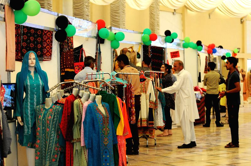 ISLAMABAD, April 30, 2017 - People visit stalls on the last day of Fashion Expo 2017 in Islamabad, capital of Pakistan, on April 30, 2017. Over 100 exhibiters participated during the two-day fashion ...