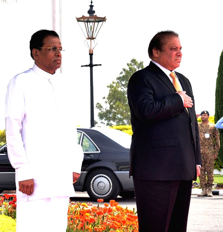 Photo released by the Press Information Department (PID) on April 6, 2015, shows Pakistani Prime Minister Nawaz Sharif (R) and visiting President of Sri Lanka ... - Nawaz Sharif