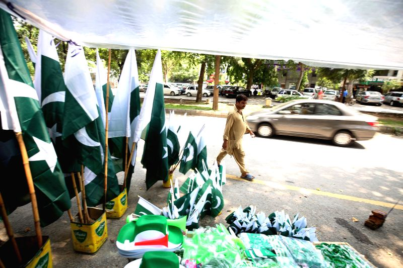 ISLAMABAD, Aug. 11, 2018 - A Pakistani man walks past a roadside stall ahead of the country's independence day in Islamabad, capital of Pakistan, on Aug. 11, 2018. Pakistan will celebrate its ...
