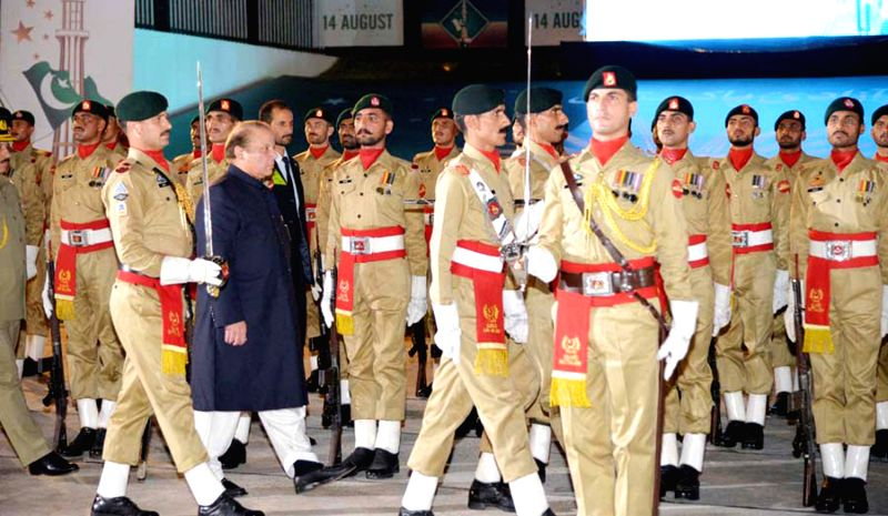 Photo released by Pakistan's Press Information Department (PID) on Aug. 14, 2014 shows Pakistani Prime Minister Nawaz Sharif (2nd L) inspects honor gurads during .