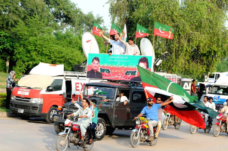 Pakistani supporters of Pakistan Tehreek-e-Insaf (PTI) party arrives in Islamabad, capital of Pakistan, Aug. 14, 2014. A Pakistani cabinet minister said on ...