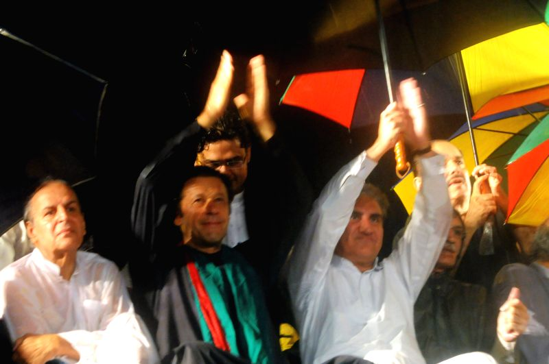 Pakistani cricketer-turned-politician Imran Khan (2nd L) gestures during a protest rally against the country's Pakistan Muslim League-Nawaz-led government in ... - Nawaz Sharif and Imran Khan