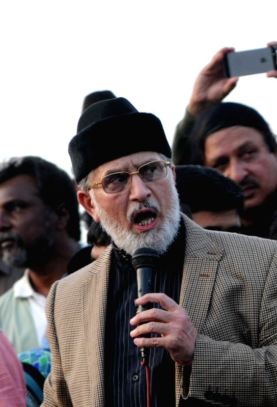 Anti-government cleric Tahir-ul-Qadri speaks to his supporters during a protest in Islamabad, capital of Pakistan, on Aug. 17, 2014. A senior opposition leader in