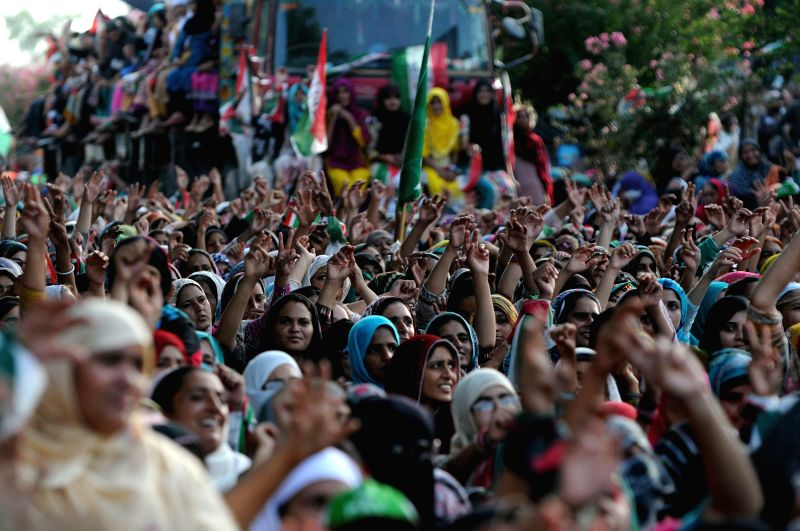 Supporters of anti-government cleric Tahir-ul-Qadri rise their hands during a protest in Islamabad, capital of Pakistan, on Aug. 17, 2014. A senior opposition ...