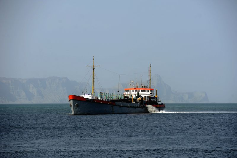 Photo taken on Aug. 18, 2014 shows a ship near Gwadar Port in Balochistan province, Pakistan. Gwadar Port is a warm-water, deep-sea port situated on the Arabian ..