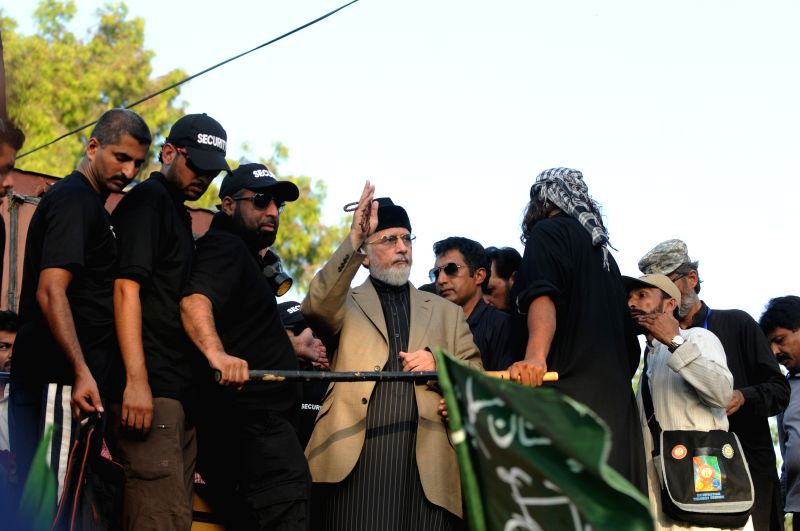Religious anti-government leader Tahir-ul-Qadri (C) gestures during a protest in Islamabad, capital of Pakistan on Aug. 19, 2014. Pakistan's interior minister ...
