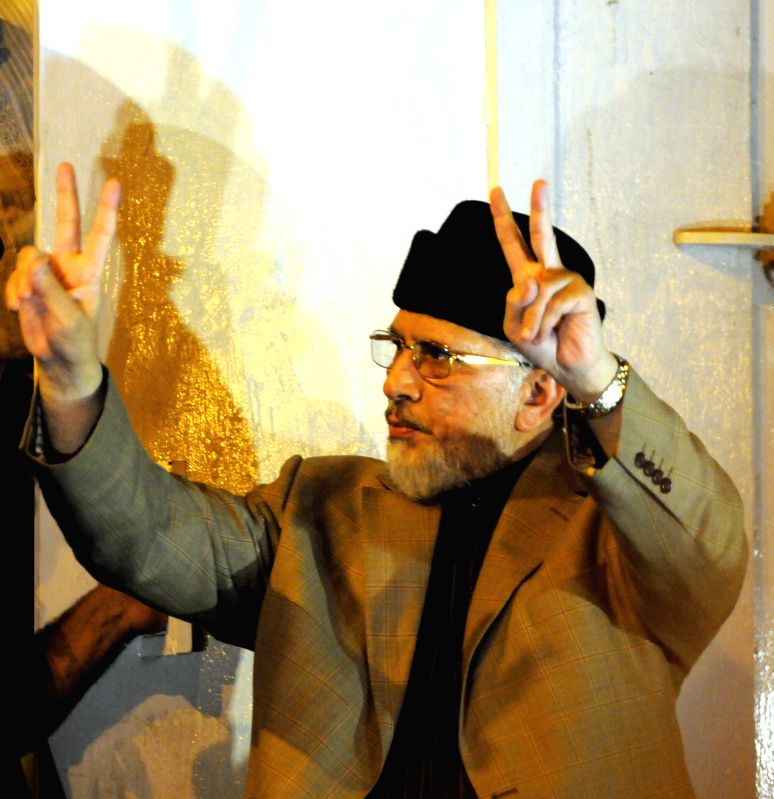 Pakistan Awami Tehrik (PAT) chief Tahir ul Qadri gestures to his supporters outside the Parliament during a protest march in Islamabad, capital of Pakistan, Aug. . - Nawaz Sharif