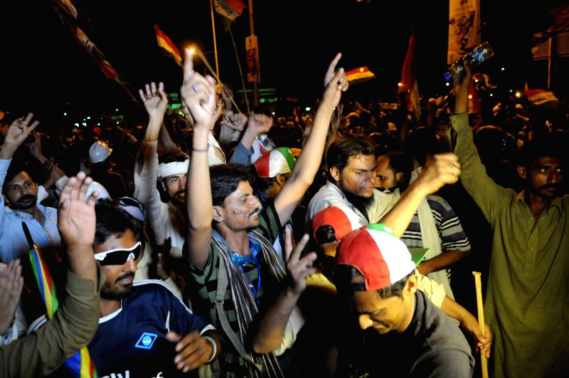 Supporters of religious anti-government leader Tahir-ul-Qadri shout slogans during a protest in Islamabad, capital of Pakistan on Aug. 20, 2014. Tens of thousands