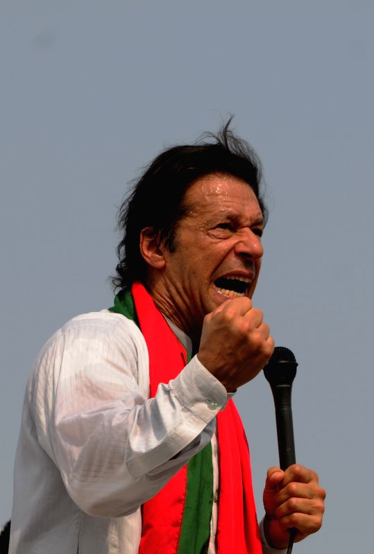 Pakistani opposition leader Imran Khan addresses his supporters during a protest in Islamabad, capital of Pakistan, Aug. 21, 2014. Pakistani parliament on ... - Nawaz Sharif