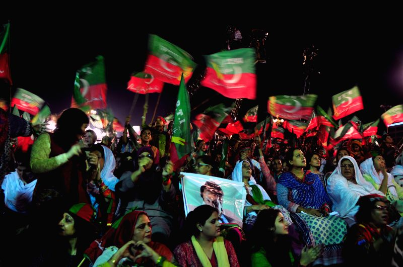 Pakistani supporters of opposition politician Imran Khan gathered in front of parliament during a protest march in Islamabad, capital of Pakistan on Aug. 21, ... - Nawaz Sharif and Imran Khan