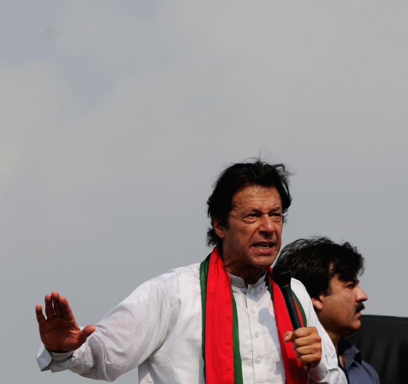 Pakistani opposition leader Imran Khan addresses his supporters during a protest in Islamabad, capital of Pakistan, Aug. 21, 2014. Pakistani parliament on ... - Nawaz Sharif and Imran Khan