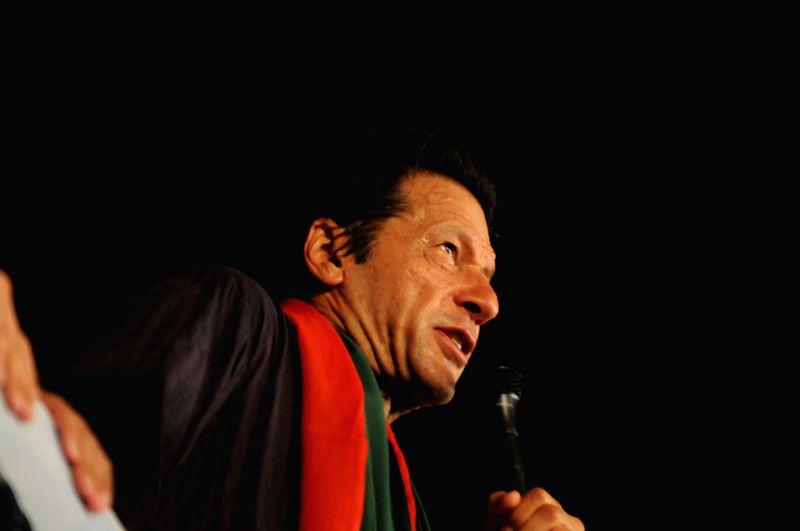 Pakistani opposition leader Imran Khan speaks to his supporters during an anti-government protest in front of the Parliament in Islamabad, capital of Pakistan on .