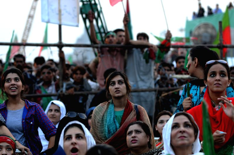 Pakistani supporters of opposition politician Imran Khan react during a protest in Islamabad, capital of Pakistan, Aug. 21, 2014. Pakistani parliament on ... - Nawaz Sharif and Imran Khan