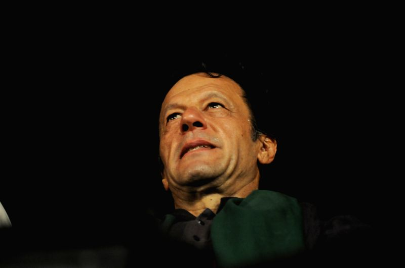 ISLAMABAD, Aug. 24, 2014 (Xinhua) -- Pakistani opposition politician Imran Khan arrives at an anti-government protest in front of the Parliament in Islamabad, capital of Pakistan, on Aug. 24, 2014. (Xinhua/Ahmad Kamal/IANS)